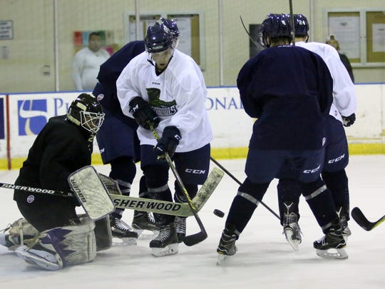Everblades players attempt to attack the goal during a drill at Tuesday morning's practice at Germain Arena.