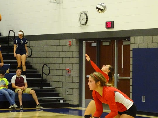 Claire Songer serves in the decisive fourth game with Jenna Karl waiting for the opponents' return.