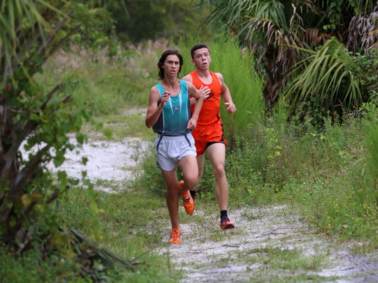 Gulf Coast's Nickolas Kamen, left, and Lely's Joshua