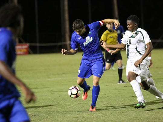 FGCU's Albert Ruiz passes the ball during Tuesday night's Battle for I-75  match-up between No. 12 FGCU and USF at the FGCU Soccer Complex.
