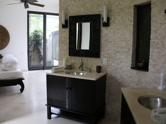 The master bedroom includes an open concept master bathroom in Richard Sommerville's Bonita Springs home which was recently renovated into a Balinese-style garden with stone path designed to reflect feng shui principles.