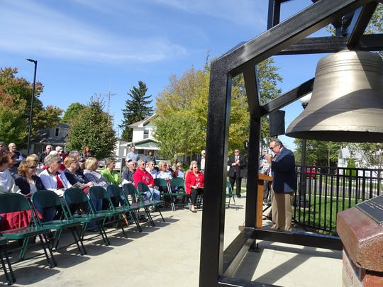 Randy Fischer explains the history of the 146-year-old bell that was dedicated on its new bell tower Friday at Bucyrus Elementary School.