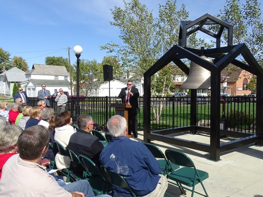 Superintendent Kevin Kimmel tells a crowd of nearly 100 about the efforts that went into constructing a new tower for the 146-year-old bell dedicated Friday at Bucyrus Elementary School.