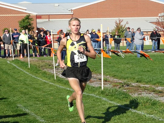 Chad Johnson races past the one-mile marker at the