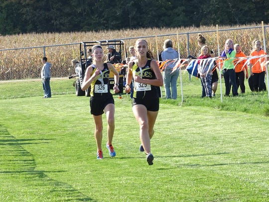 Anna Reffey and Emily Kemper run down the final stretch toward the finish line en route to  second- and third-place finishes, respectively.
