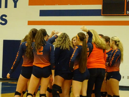 The Lady Tigers huddle together in the first game en