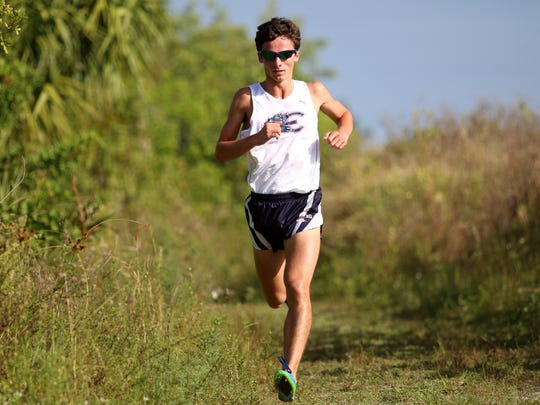 Estero senior Arye Beck holds on the a first place lead during Thursday morning's District 3A-12 meet at Palmetto Ridge High School in Naples, Florida. Estero, Naples, Gulf Coast and Barron Collier will advance to next week's regional championship.