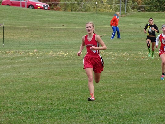 Julia VanVoorhis runs in  the final stretch of the