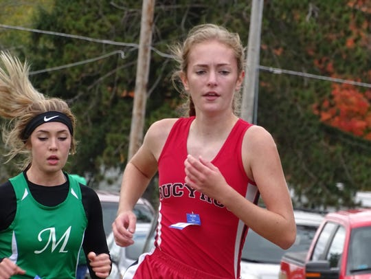 Julia VanVoorhis passing the one-mile marker at Amman's