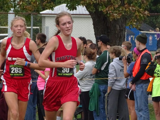 Julia VanVoorhis beats out the St. Henry runner just