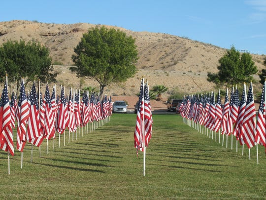 Rows of flags in decorate the field at the Mesquite