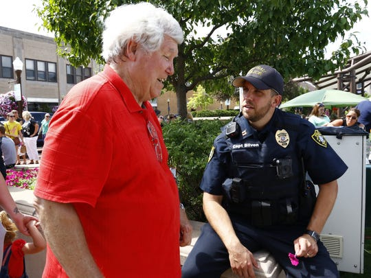 Wausau Police Department Capt. Benjamin Bliven, right, mingles Tuesday with Tom Jacob during the Wausau Police Department's Community Thank You event at The 400 Block in downtown Wausau.