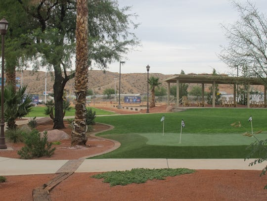 The backyard of the Rising Star offers a putting green,