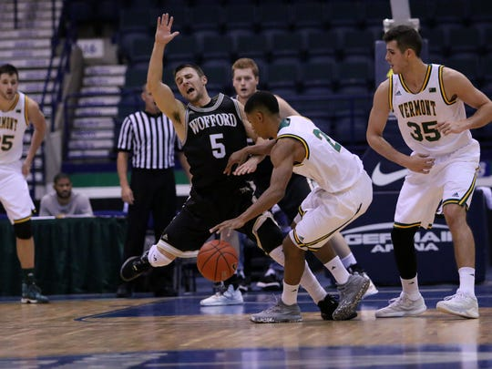 Wofford's Eric Garcia is foulded during the first game of the Gulf Coast Showcase Tournament between Wofford College and Vermont at Germain Arena on Monday, Nov. 21, 2016.