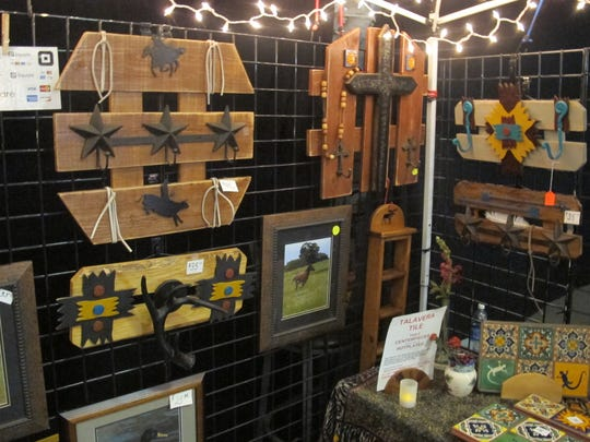 Barbara and Joe Sterling of BarleeJoe Crafts sell homemade woodcrafts, tile creations, and jewelry.