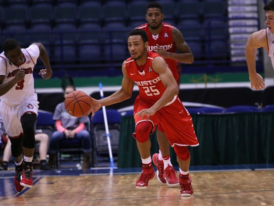 Galen Robinson dribbles down the courtl during the first half of the Gulf Coast Showcase semifinal between Houston and South Dakota on Tuesday, Nov. 22, 2016.