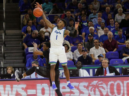 FGCU's Reggie Reed reaches to recover the ball against Binghamton at Alico Arena on Wednesday, Nov. 23, 2016.