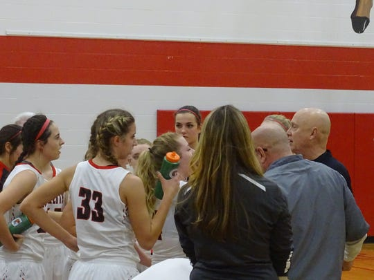 Buckeye Central huddles in the first quarter during a timeout. The Buckettes would start off the game on a 21-2 run.