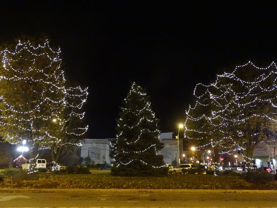 Christmas lights hang from trees in the Bucyrus square.