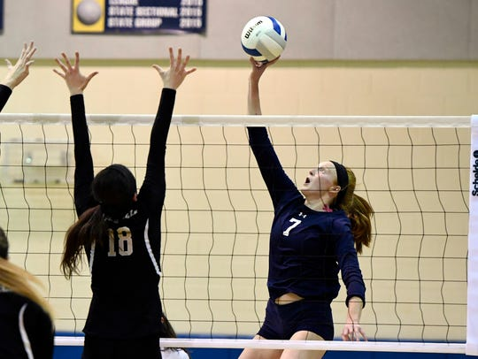 IHA junior outside hitter Catherine Fazio (7).