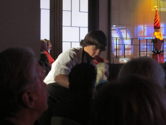 Tyler Parker passes out cookies baked by the VVHS culinary program to audience members on Tuesday night.
