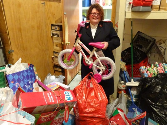 Capt. Annie Buckles of the Bucyrus Salvation Army holds