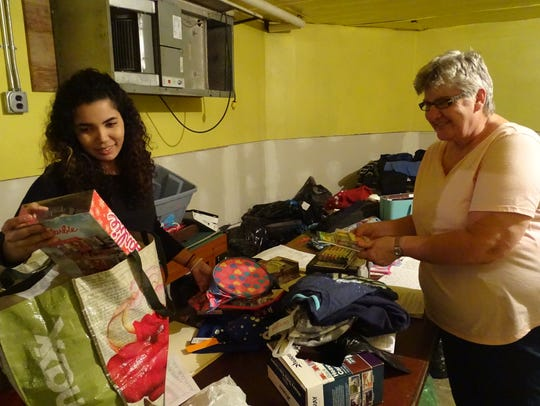 Bernice Canales, left, and Kathy Dorchak sort through
