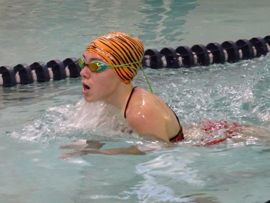 Mansfield Senior's Hailey Jacobs takes a breath mid-stroke