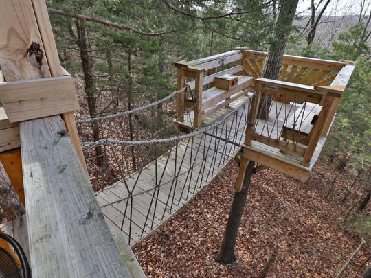 Misty View is a romantic cabin with a private coffee deck connected to the regular deck via a swinging bridge. The bridge feature became so popular that the owners are planning to incorporate that design into most future cabins.