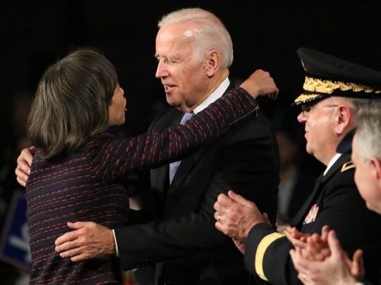 Sen. Lisa Blunt Rochester gives former Vice President Joe Biden a hug after speaking at his return to Wilmington rally on Friday after leaving office.