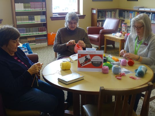 From left, Judy Brown, Cindy Wert and Heidi Wurm work on their yarn projects Thursday during their crochet club meeting at the Bucyrus Public Library.