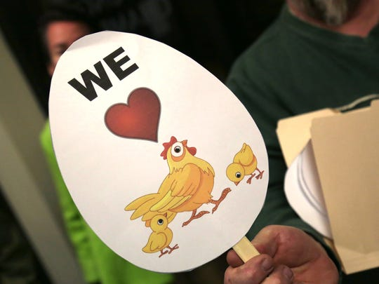 Supporters of the backyard chicken bill brought egg shaped paddles to show their support of the issue during a session at Mansfield City Hall on Tuesday night.