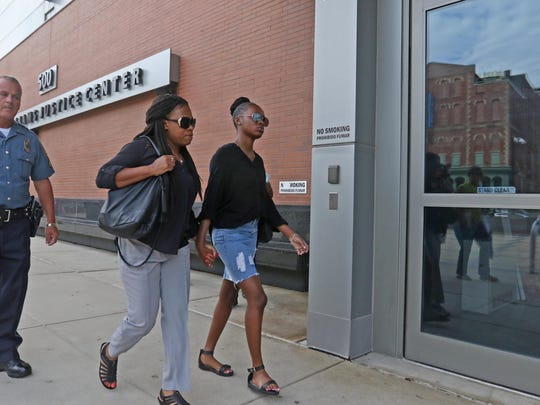 Trinity Carr, accused in the death of her classmate Amy Inita Joyner-Francis, walks into the New Castle County Courthouse. Her trial is scheduled to begin in Family Court on Monday.