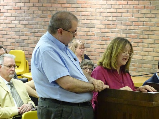 Beth and Doug Eckersley, of Bucyrus, testify Monday before the Ohio Public Utilities Commission during a hearing in Bucyrus about the potential of allowing electric companies to raise their base rates statewide.