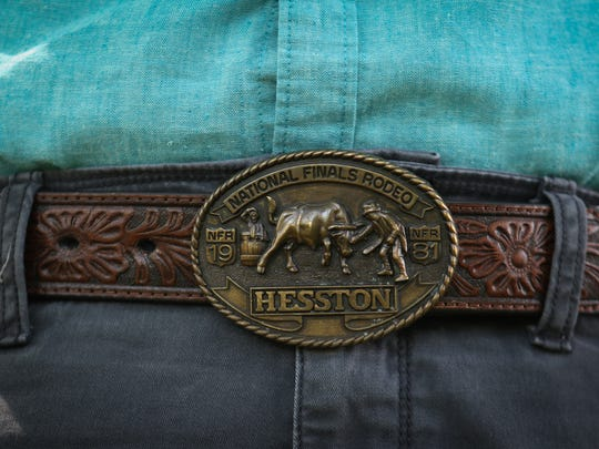 James Dawson wears a belt buckle from 1981 Heston National Finals Rodeo.