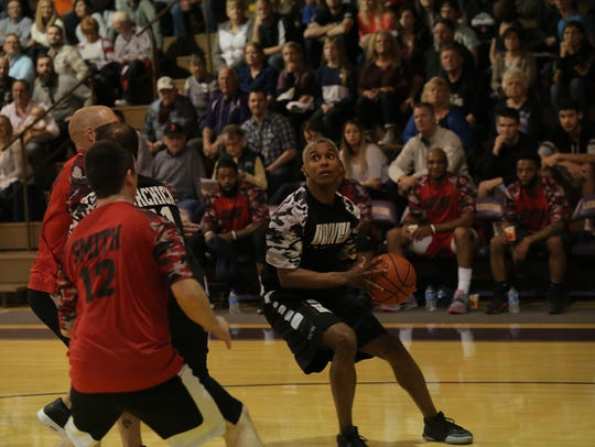 Former safety Gary Berry plays in a celebrity basketball