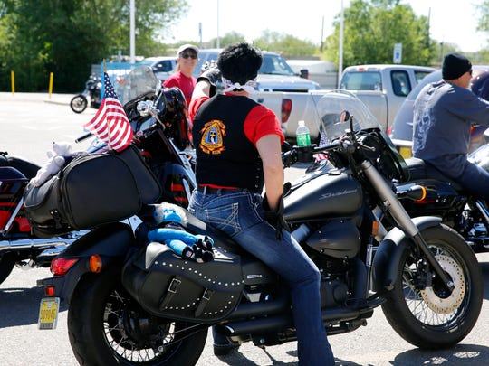 Members of the Christian Motorcycle Association prepare to leave the Healing Field Monday, May 29, 2017, at the Farmington Boys & Girls Clubs in Farmington.