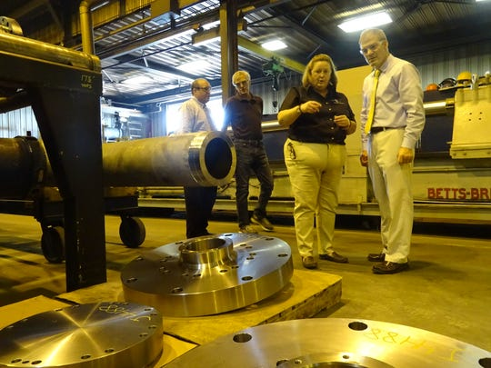 Annie Carter of Carter Machine shows U.S. Rep. Jim Jordan around her Gaion factory Monday afternoon.