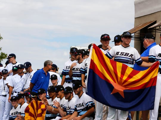 Players from the All-Star Baseball Academy, of Phoenix, and the Florida Legends, of Miami, ride on a float during the Connie Mack World Series Parade in Farmington on Friday.