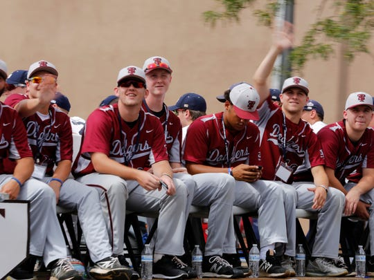 The South Troy Dodgers, of Troy, N.Y., take part in the Connie Mack World Series Parade on Main Street in Farmington on Friday.