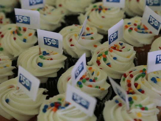 Cup cakes fill the table during the 150th anniversry