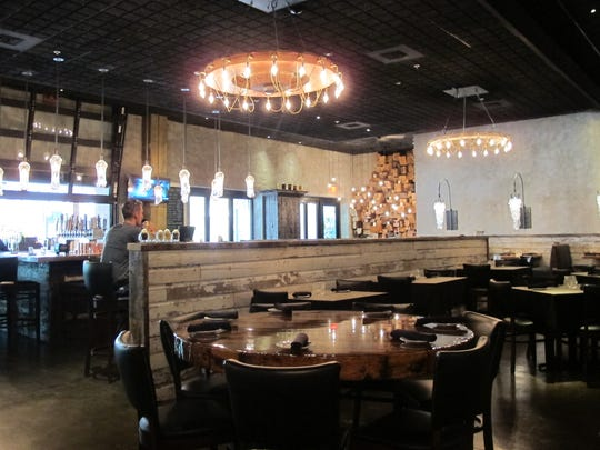 Burntwood Tavern has a rustic interior at Mercato in North Naples.