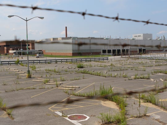 Grass grows in the parking lot of the former 142-acre Fisker Automotive plant, formerly know as the Boxwood plant near Newport. A meeting will be held Thursday night to talk about the site.