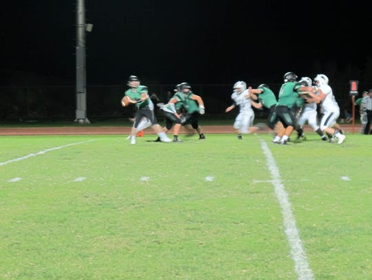 Virgin Valley senior quarterback Cade Anderson fires