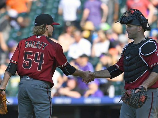 Diamondbacks reliever Jimmie Sherfy (left) shakes hands