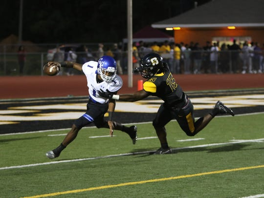 Starkville's Zach Edwards chases down Meridian quarterback Tevarrius Adams in the first quarter of Friday night's game.