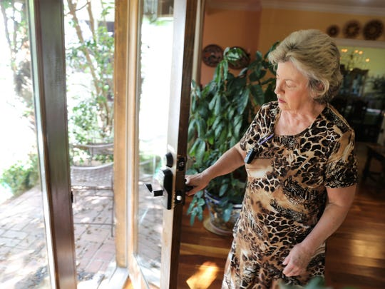 Innkeeper Linda Kimmel of the Casa Blanca Inn and Suites in Farmington shows where burglars entered the bed and breakfast inn earlier this week and stole more than $13,000 in property.