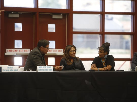 Navajo Nation Council Speaker LoRenzo Bates, left, talks with New Mexico Motor Vehicle Division employees during the town hall meeting on Friday at Navajo Technical University in Crownpoint.