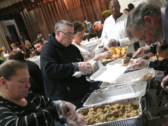 Volunteers help prepare to-go meals for Thanksgiving
