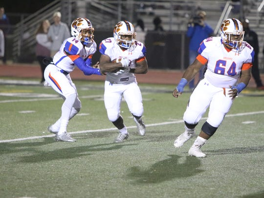 Madison Central Jaguars running back Cedric Beal takes